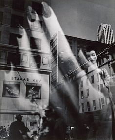 Lisette Model. Reflections, New York City, 1939-45. One of her students was Diane Arbus.