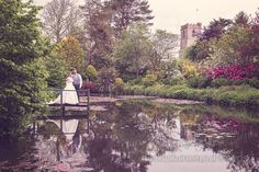 Bride and Groom next to lake at The Priory Wareham wedding. Photography by one thousand words wedding photographers