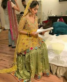 Wedding brida yellow and mehndi green color with gota dabka zari nagh threds work Model 108 Pakistani Mehndi Dress, Bridal Mehndi Dresses, Pakistani Formal Dresses, Shadi Dresses, Pakistani Wedding Outfits, Bridal Dress Design, Pakistani Dress Design, Bridal Outfits, Nikkah Dress