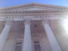 Close up shot of Auckland Baptist Tabernacle, Corinthian capitals influenced by Ancient roman architecture.