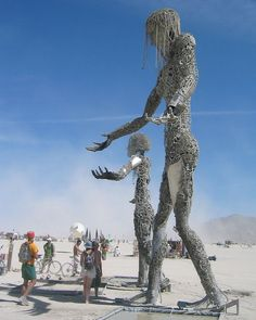 Iron human sculptures at the Burning Man festival Loved and Pinned by www.downdogboutique.com to our Yoga community boards