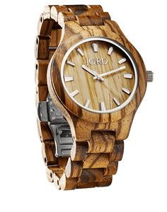 The Fieldcrest Series is produced in a classic midsize. The monochromatic wood face, bezel, and strap serve to showcase the intricacy of the wood grain.  Designed to be androgynous, the attitude of the wearer is the final elemental design to this timepiece.