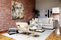 Brick Abode - Tze Chun, owner of the online gallery Uprise Art, truly made her open-plan NYC apartment into a masterpiece. Hypebeast, Wassily Chair, Graffiti, Car Wall Art, Inspirational Posters, Nyc, Living Room Furniture, Living Rooms, Studio Apartment Furniture