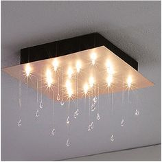 Crystal Rain Lighting is a beautiful lamp hanging from the ceiling and having a particular and unusual design.
