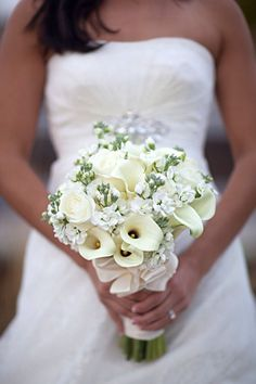 White calla lilies and white roses bouquet