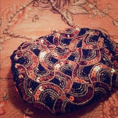 Darling evening clutch bag ❤️ Sequins and attached shoulder strap . Fabulous earth tones . Used once for a wedding. It's a fabulous clutch ,.  Bags Clutches & Wristlets