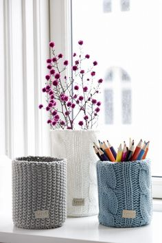 Knitted Vases from Ferm Living by Izabella. This would be easy to recreate with big cans and knitting in the round, or old sweater sleeves.