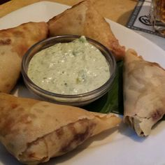 Chicken Samosas w/ Cilantro Sauce. The Cheesecake Factory Eat More Chicken, Cilantro Sauce, Good Food, Yummy Food, Indian Food Recipes, Ethnic Recipes, Restaurant Reservations, Homemade Sauce, Tasty Dishes