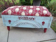 An old dresser drawer turned foot stool. Sweet!