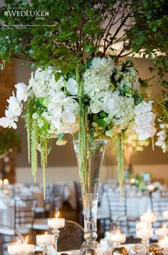Beautiful flowers! Love the simple and natural colours, but their dramatic arrangement!!