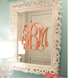 Coral initials on mirror with white frame-- so pretty!
