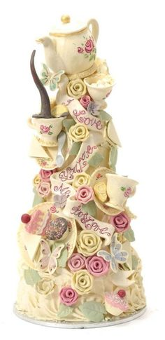 Tea party cake or modify for Alice Wonderland- awesome wedding cake for teapot lover!
