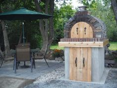 The Stanwood Oven is a great example building an outdoor pizza oven with fire brick, natural stone veneer and wood for that final touch.  This oven means business!  To see more pictures of this oven (and many more ovens), please visit - BrickWoodOvens.com
