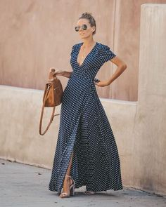 Best Seller Polka dots are timeless and so are wrap maxi dresses! Our Cara Polka Dot Wrap Maxi Dress combines both in a navy and white polka dot theme on a true wrap silhouette. Featuring a natural draped neckline, short sleeves and a natural front slit Elegant Dresses, Casual Dresses, Summer Dresses, Summer Maxi, Vintage Dresses, Dress Outfits, Fashion Dresses, Cute Outfits, Maxi Wrap Dress