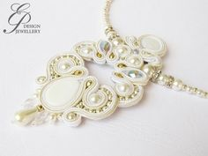 This is an elegant soutache necklace with natural shell cabochon, pearl beads, clear crystals and silver japanese seed beads. The exclusively elegant,