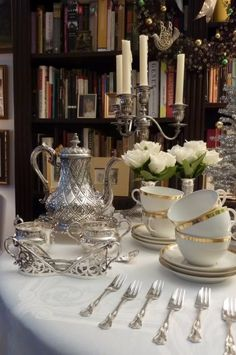 The table was simply decorated with a old silver foil tree decorated with vintage gold mini glass ornaments. Along with the tree, a pair of English sterling ...