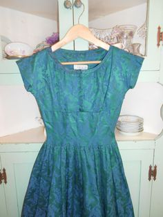 1950s Pat Hartly Original Brocade Party dress--brocade is in a lily of the valley pattern.