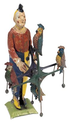 tinplate toy clown with performing parrots, late 19th century