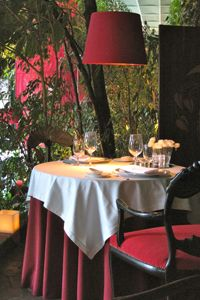 Tables at the romantic Belvedere Restaurant are surrounded by plants that are 150 years old.