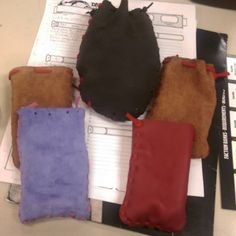Gregg made some #leather dice bags. They are a thin soft swaude except for the big dark brown one. That one feels more like an old leather jacket. Beautifully worn in.  #dice #bag #diy