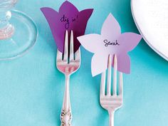 Pretty Place Cards using a punch; would add color to the table depending on paper used
