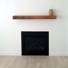 reclaimed wood fireplace mantel | ... , directing the eye towards the feature wall with the fireplace