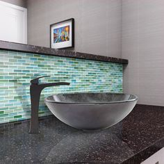 The Blackstonian vessel faucet compliments any vessel sink with it's lovely matte black finish.