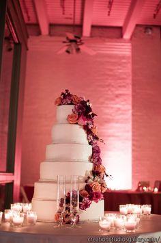 orange wedding, pink wedding, orange and pink wedding, orange and white bride's bouquet, andria lewis events, flowers on wedding cake, wedding cakes, pink lighting