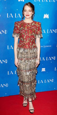 Emma Stone piled on the fun at the La La Land premiere in Paris with a floral-embroidered Chanel design that boasted a shiny tinsel-happy fringe skirt. She finished her look with Sara Weinstock studs, Graziela Gems earrings, and black ankle-strap Jimmy Choo sandals.