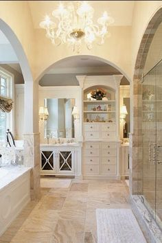 Traditional Master Bathroom with MSI Cappuccino 12 in. x 12 in. Polished Marble Floor and Wall Tile, Chandelier, Glass panel
