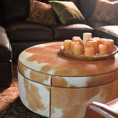 "Cowboy Ottoman  ---  make an ottoman the centerpiece of your room! Dramatic cowhide, 38"" in dia."