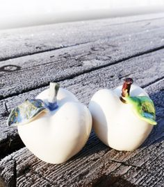 Our white pocelain apples - perfect favors for a frozen fantasy wedding.