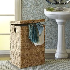 A laundry holder pretty enough to set out in the open? Refreshing. Our Carson hamper is made of natural—and naturally durable—water hyacinth, hand-woven over a sturdy iron frame with a removable fabric liner. So at least one part of doing laundry is attractive.
