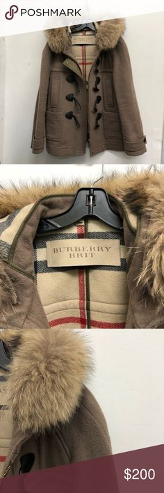 BURBERRY BRIT WOMENS DUFFLE TOGGLE COAT 100% Authentic Pre-Loved Burberry Brit women's wool duffle toggle fox fur hooded camel coat | Gently used worn with small hole on the bottom (see picture) good condition | Size: 14 | Thank you for looking at my closet and please contact me with any inquiries. Have a awesome day! Burberry Jackets & Coats Trench Coats