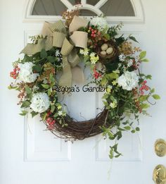 Spring Wreath-Fern Wreath-Rustic Greenery Wreath-Wreath for Door-Easter Wreath-Ivy Wreath-Rustic Wreath-Cottage Chic-Woodland Wreath  This natural looking wreath is designed with realistic looking ferns, seeded eucalyptus, ivy and jasmine. Snowball viburnum, winding vines with coral berries and cascading chartreuse-flowered vines add a light and lovely touch of color to this nature-inspired wreath. A birds nest with speckled eggs is nestled into the greenery. A double bow of cream canvas and…
