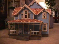 """Bayberry Dollhouse - this is the kit my parents have in their garage. Not a fan of how it is """"out of the box"""" but with some modifications and bright colors could be awesome for Molly."""