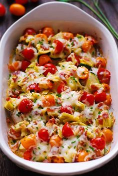 Baked Italian Chicken and Vegetables. Chicken Breasts are seasoned with basil and topped with veggies: artichokes, tomatoes, zucchini. Bake this Italian chicken in the casserole dish topped with the Mozzarella cheese. Chicken And Vegetable Bake, Vegetable Recipes, Pesto Chicken, Baked Vegetables, Chicken And Vegetables, Italian Vegetables, Healthy Chicken Recipes, Cooking Recipes, Italian Baked Chicken