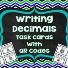 This set of 24 task cards reviews writing decimals in word form, standard form, and expanded form. Each card contains a QR code with the answer for...