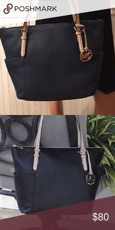 Jet Set Item Tote This is a barely used MK zip Tote! Very good condition and a very useful and practical bag! It is in navy! Michael Kors Bags Shoulder Bags