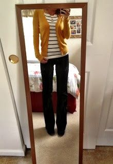Love the mustard sweater over navy stripped shirt.