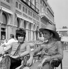 English musician Keith Richards with Anita Pallenberg, sitting outside the Excelsior Hotel, Lido, Venice, 1967.
