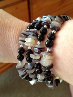 Memory wire bracelet of Black Lip Shell squares, 10mm Jet glass round beads, and 6mm silver plated round beads.  my Creative Outlet: Crafty at the coast...
