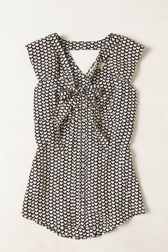 Yes to this heart print tie neck sleeveless blouse. Shirttail hem, V neck, black and white graphic print, silk!