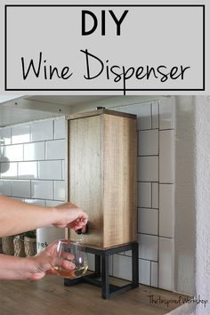 DIY Wine Dispenser - Build this easy wine dispenser to create an elegant way to drink your box wine! Don't let your guests know it's box wine, let them dispense it in style! A must have for holiday gatherings, Thanksgiving Dinners and a Christmas gift option for any hostess gifts or gift for any wine lover in your life! Handmade gifts are the best!#winelovers #winegifts #DIYgiftideas