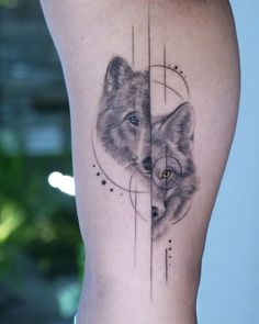 A split wolf tattoo by Eva Krbdk Loup yeux jaunes Two Wolves Tattoo, Wolf Tattoo Back, Arm Band Tattoo, Spirit Animal Tattoo, Animal Tattoos, Insect Tattoo, Cute Tattoos, Body Art Tattoos, Tatoos