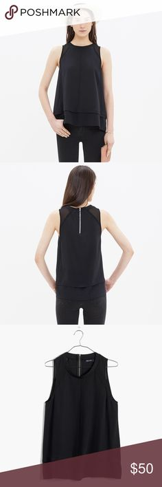 """Madewell Silk Incline Tank in Black Excellent condition. Worn twice and dry cleaned. PRODUCT DETAILS: This swingy silk shirt has a sporty ribbing neckline and a refined mix of solid and see-through. As easy to wear as a T-shirt, it's the perfect pick when you need something a bit more polished.    True to size. Silk. Dry clean. 16.5"""" across chest, 24.5"""" long. Madewell Tops Tank Tops"""