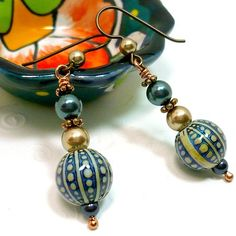 Decorative orb mood beads mixed with Swarvoski crystal pearls make these unique earrings both decorative and fun.  Mirage mood orb beads are so fun as they change color according to the...@ artfire