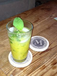 Mango Mojito.   Created this last night.  Yummy!  Puree half a mango (set aside).  Muddle 10 mint leaves with one tsp sugar in a shaker.  Add the juice of 2 limes.  Add 4 oz dark rum and 6 oz club soda.  Pour in puree, shake, and serve.  Makes two tall drinks.  Enjoy!
