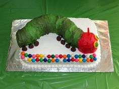 A Very Hungry Caterpillar Birthday Party! love the author don't know how i feel about a caterpillar on a cake..