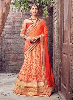 Buy online latest designer party wear sarees collection. Grab this faux chiffon, faux crepe and net embroidered and patch border work lehenga saree.